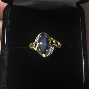 14 Kt Yellow Gold Blue stone.
